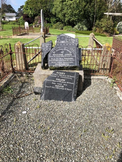 The headstone of William and Rachel Judge in the Wallacetown cemetery before the repair work was...