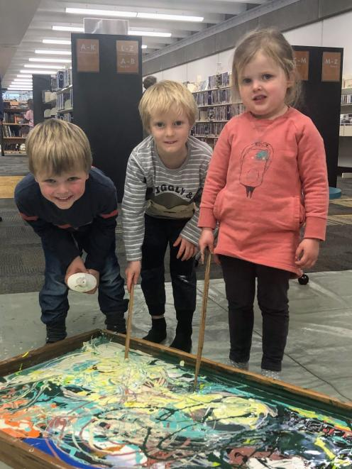 Max Brown (5), Levy Harrison (5) and Maggie Brown (3) were hands-on painting the mural.