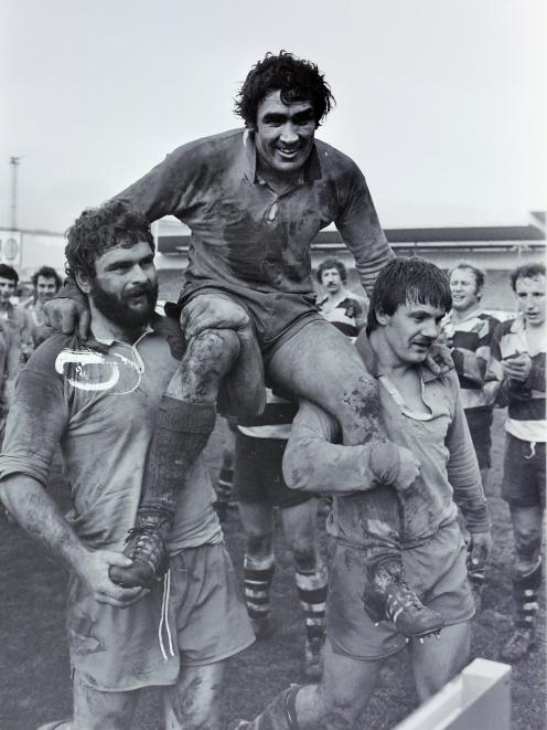 Dick Bunton (left) and Keith Caldwell carry victorious captain Mervyn Jaffray off Carisbrook...