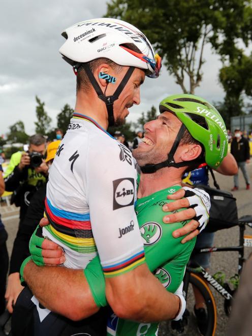 Deceuninck-Quick Step  rider Mark Cavendish (right), of Britain, celebrates winning stage 10 of...
