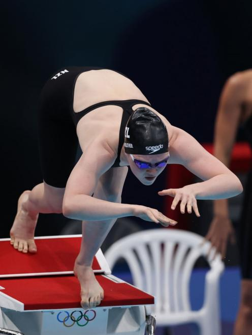 Erika Fairweather dives in at the start of the 4x200m relay last night at the Tokyo Olympics....