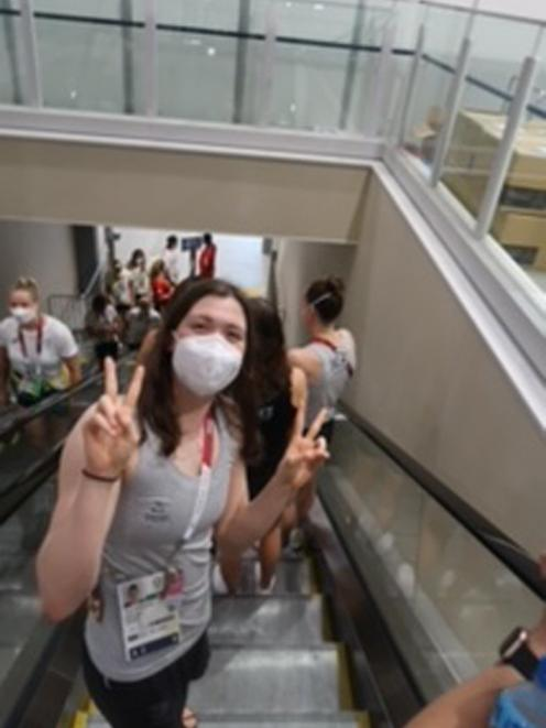 Erika Fairweather takes a ride down an escalator during some downtime at the Olympic village in...