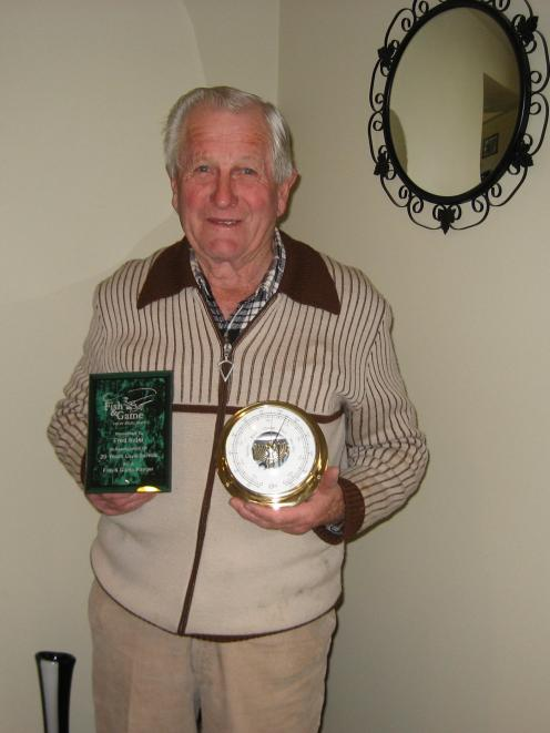 Fred Inder holds some of the many awards he received. PHOTO: THE NEW ZEALAND HERALD
