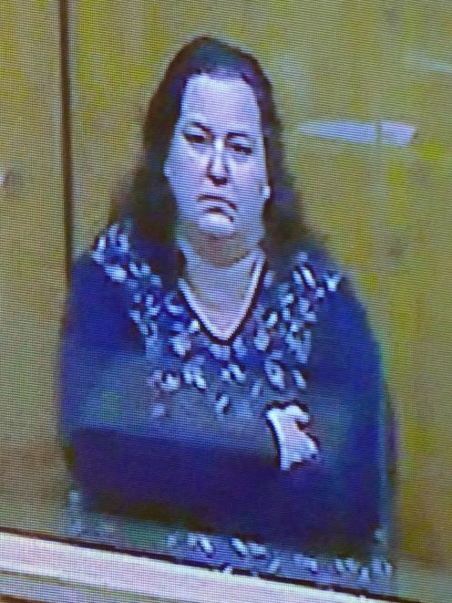 Sarah Day, appearing by video link, has been sentenced to 10 months' home detention. PHOTO: ROB KIDD