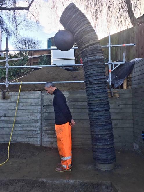Arrowtown sculptor Shane Woolridge demonstrates the ''field punishment No1'' position, the...