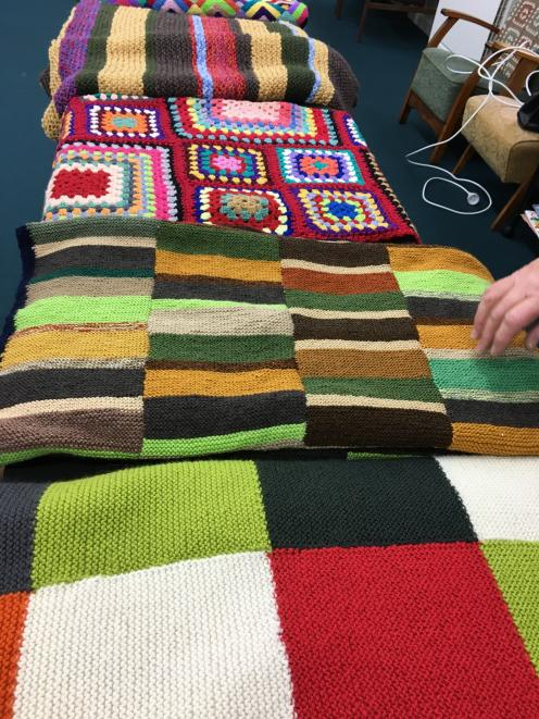 Some of the hundreds of knitted items donated by Dunedin and Mosgiel knitters for Operation Cover...