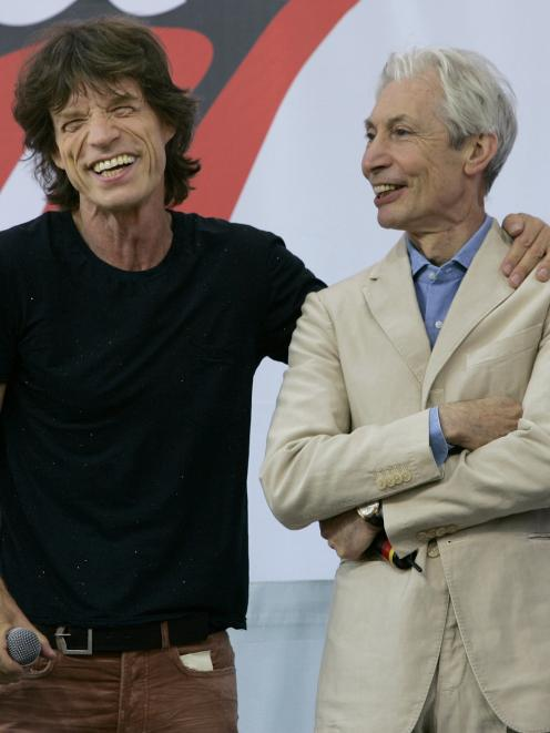 Charlie Watts with frontman Mick Jagger. Watts was always known as a keen shopper and a snappy...
