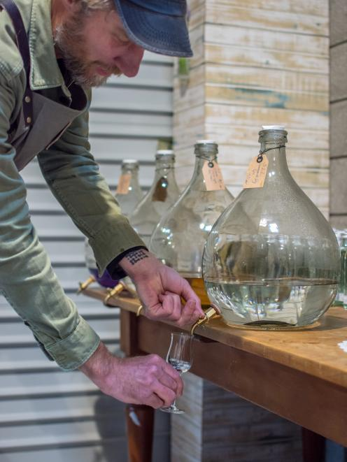 Paul Schneider pours a sample of his gin from the Coromandel Distilling Company in Thames.