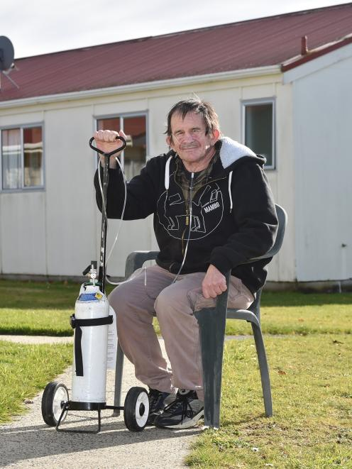 """Glenn Blundell (58), of Mosgiel, says clean air would make """"a heck of a  difference"""". Photo:..."""