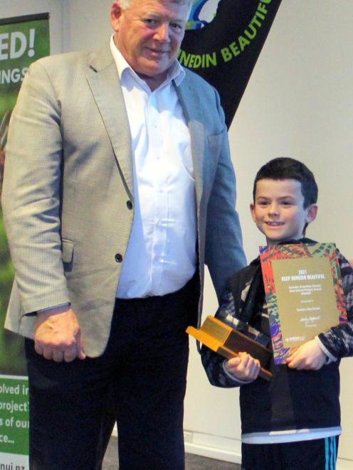 Sawyers Bay School pupil Hunter Swete (10) accepts the Dunedin Amenities Society Best School...