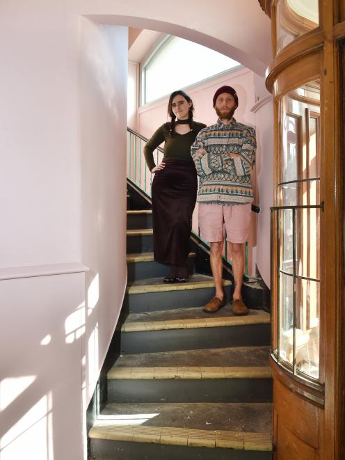 Soon-to-be-evicted tenants Abby Fleur and Reamonn Thomson-Dudding stand in the freshly painted...