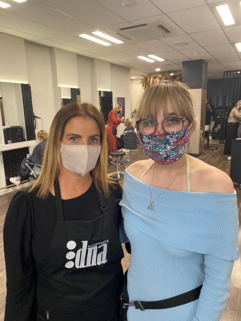 """DNA Ashburton employees Sara Baird (left) and Katya McCallum say the salon has been """"as busy as..."""