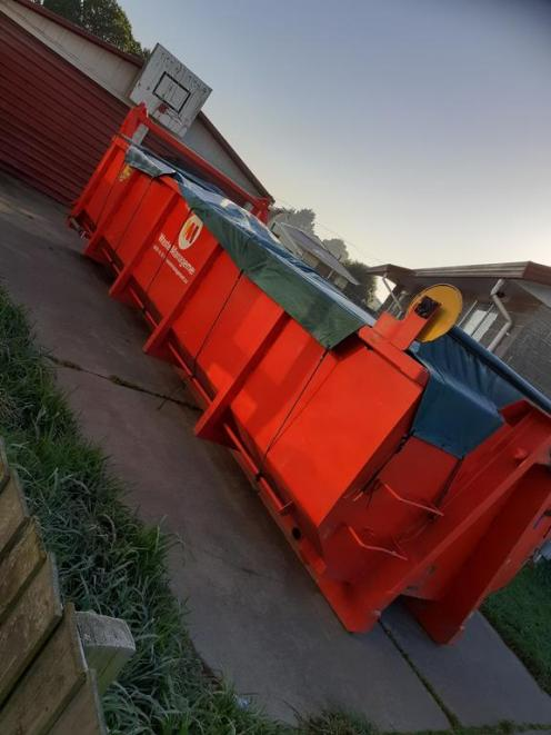 The skip where three-quarters of the family's possessions ended up. Photo: Supplied