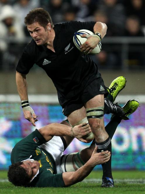 All Blacks captain Richie McCaw tramples over Springboks loose forward Ryan Kankowski in Wellington in 2010. PHOTO: GETTY IMAGES