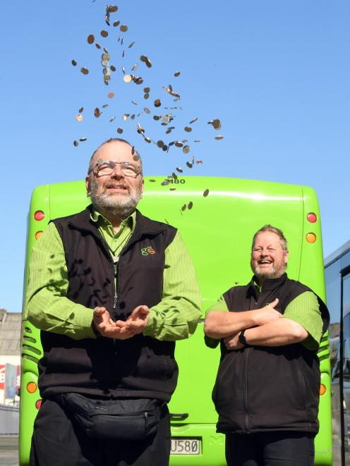 Go Bus drivers Peter Dowden (left) and Philip Matthews celebrate after Go Bus and the Otago...