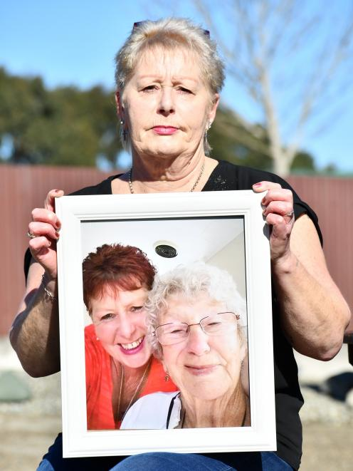 Joanne Watson, holding the last photo taken of her and her mother Nancye MacKenzie, says the...