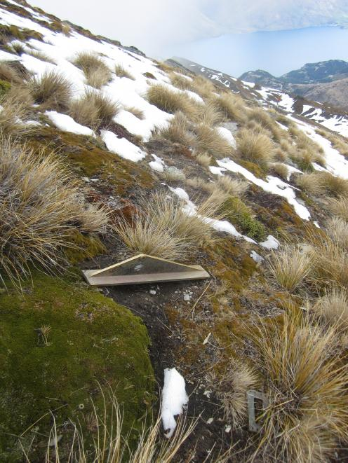 Parts of the plinth strewn across the summit, after an apparent lighting strike last month. Other...