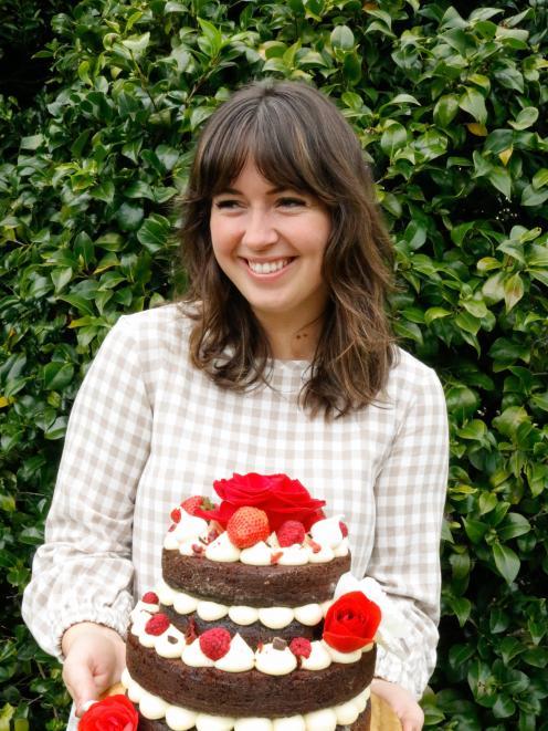 Natasha Cameron holds a chocolate Guinness cake  she made for a 21st. PHOTO: SUPPLIED