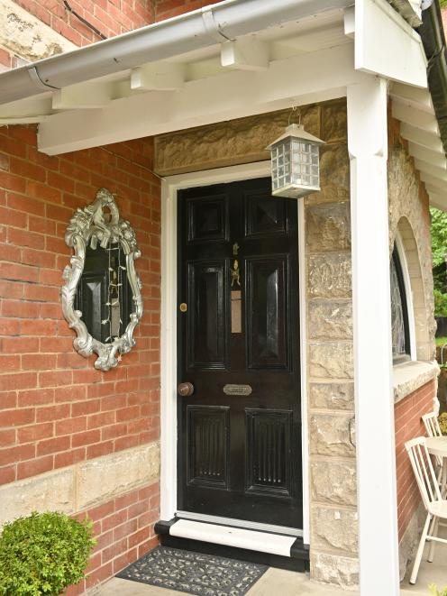 The exterior detailing includes rough-hewn Oamaru stone arches and quoining.