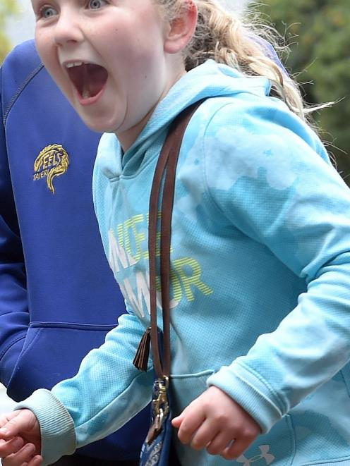 Kaikorai Primary School pupil Libby Allison (10) reacts when a fellow pupil is soaked at the...