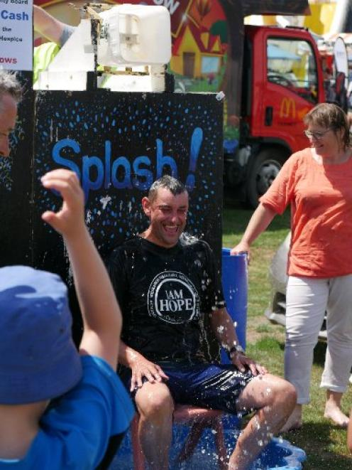 Refreshing... Saddle Hill Community Board chairman Scott Weatherall cools off at the community...