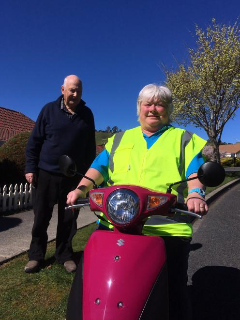 Support worker Robyn Ruddell, on her new scooter, was nominated as a ''Top Type'' by Mike Beath....