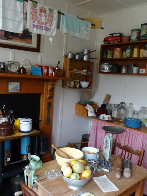 A historic New Zealand kitchen and living area is a feature of the Taieri Historical Museum and...