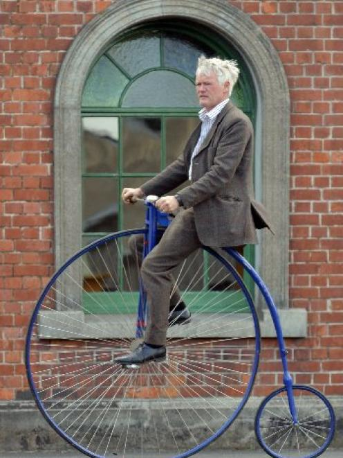 Riding in style ... Riding his home-built penny farthing during last year's Dunedin Tweed Ride...