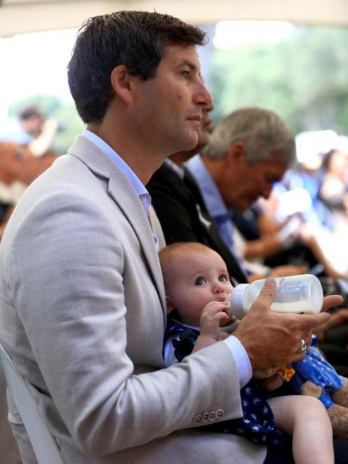 The Prime Minister's partner Clarke Gayford feeds their daughter Neve on the upper marae. Photo:...