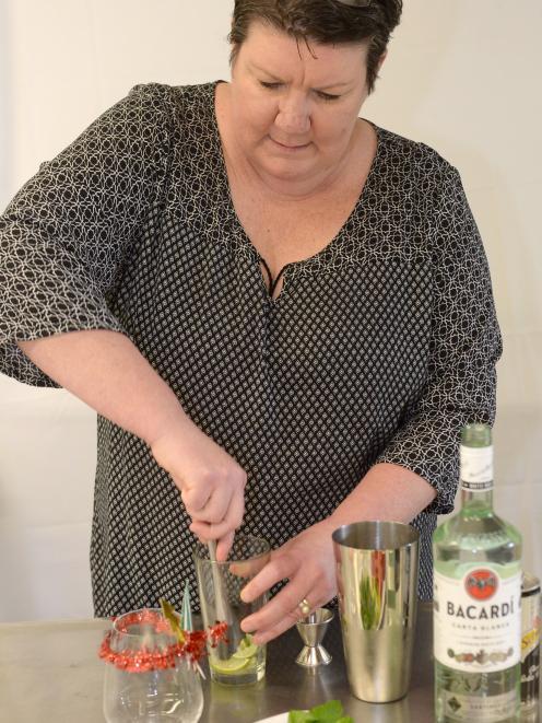 Fiona McLaren demonstrates a muddler as she creates ''Santa's little helper''. PHOTOS: LINDA...