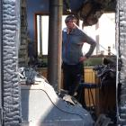 Cluden Station co-owner Sam Purvis inspects the damage. Photos by Mark Price.