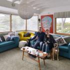 Scott and Ayla Hawkins, with dogs Vauxhall and Neka, sit in the living room of their St Leonards...