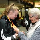 Gold medallist Anna Grimaldi is congratulated by her grandmother Lennie Anderson after arriving ...