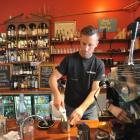 Dog With Two Tails cafe owner Chris Wilson says good coffee is the cafe's strength. Photos by Craig Baxter.