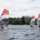 A group of young sailors get to grips with the Bic training boats during a sailing clinic on Lake...