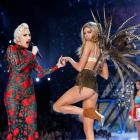 Victoria's Secret model Stella Maxwell struts on the catwalk with popstar Lady Gaga at the...