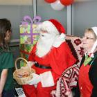 IMG 6507: Father Christmas and Santa's helper Dot McKay of Fresh Choice hand out the lollies at...