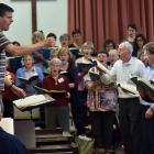 David Burchall, conductor and musical director of City Choir Dunedin's Christmas Oratorio, takes a full choir rehearsal for the production. Photo by Peter McIntosh.