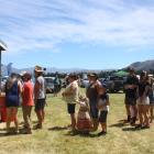 People line up at a collection booth to pick up their winnings at the Lake Hawea Picnic Racing Club race meeting. Photos by Tim Miller.