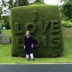 Lois Skellett with the Warrington love hedge. Photo by Chris Skellett.