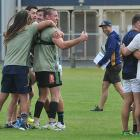 Highlanders players form groups during a game at their first training session of 2017 at the...