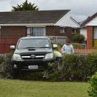 A Toyota ute came to rest in a hedge on Tedder St, St Kilda, after a collision yesterday. PHOTOS:...