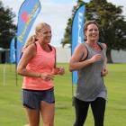 Jackie Ollerenshaw (left) and Anna Milne cross the finish line of the Ken Milne Classic event in...