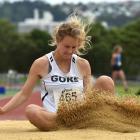 Emma Hopcroft, of Gore, lands during the women's under-20 long jump.  Photos: Gregor Richardson.