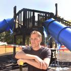Mosgiel Community Playgrounds Trust chairman Geoff Woodcock at the fire-damaged playground at Mosgiel Memorial Park yesterday. Photo by Peter McIntosh.