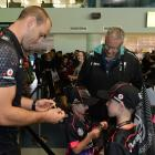 Warriors player Simon Mannering signs an autograph for Darcy (6) and Alex (8) Tavendale as their parents Matthew and Adrienne look on. Photos by Linda Robertson.