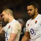 England's Mike Brown (L) and Billy Vunipola leave the field at the end of the match. Photos:...