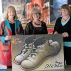 Polish Heritage of Otago and Southland Charitable Trust members (from left) Ewa Rozecka-Pollard, Cecylia Klobukowska and Bozena Misiewicz-Haug holding a poster by Mieczyslaw Gorowski of 1989. Photos by Linda Robertson.