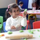 Nagham Al-Aashoor (3) enjoys playing at baking during the opening of the new Wild Things Kotuku...