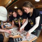 Pupils from Te Kura Kaupapa Maori o Otepoti identify moths at Orokonui Ecosanctuary. Photo: Laura...